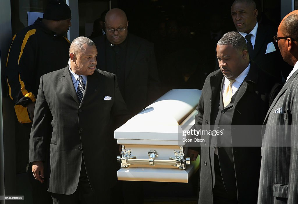 Pallbearers carry the remains of six-month-old Jonylah Watkins from New Beginnings Church following her funeral service on March 19, 2013 in Chicago, Illinois. Watkins was shot, along with her father, while sitting on her father's lap in the family's minivan March 11. Jonylah died the following day. Her father is recovering from his wounds.