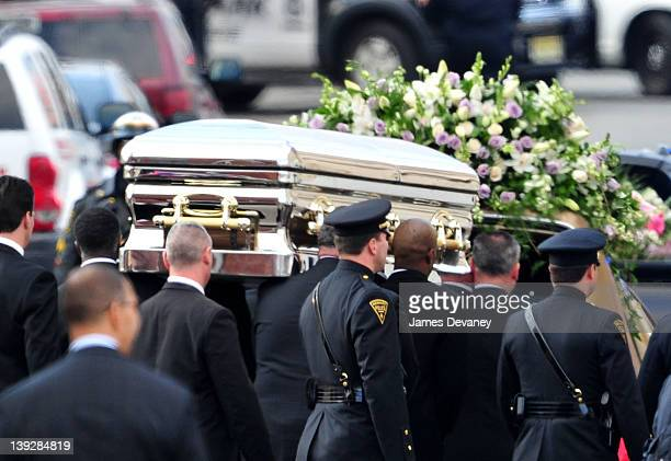 Pallbearers carry Whitney Houston's casket to a hearse outside New Hope Baptist Church after funeral services on February 18 2012 in Newark New...