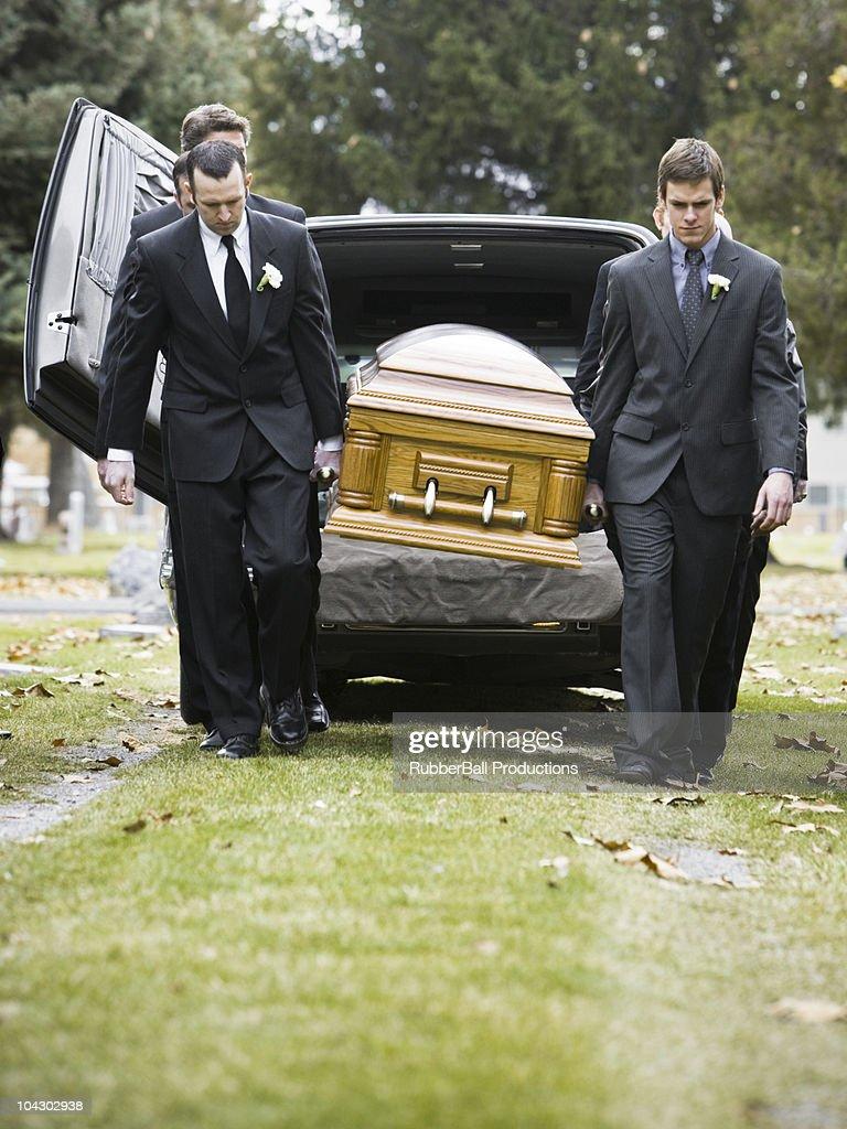 pallbearers carrying a casket : Stock Photo