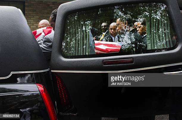 Pallbearers escort the casket of Walter Scott into a hearse following the funeral at WORD Ministries Christian Center in Summerville South Carolina...