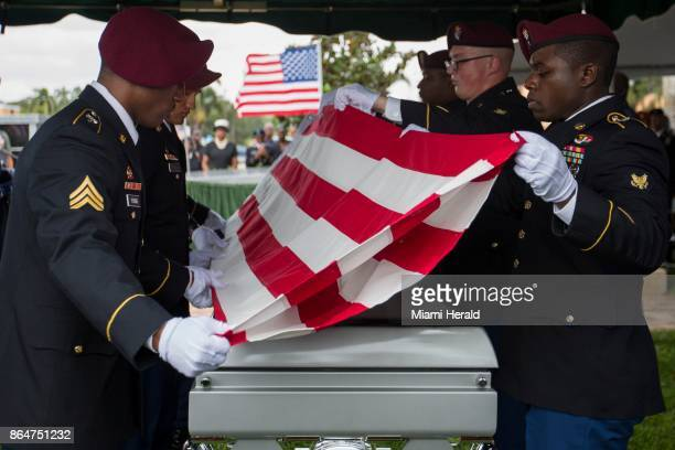 Pallbearers fold the flag draped over the casket of Sgt La David Johnson during his burial service at Fred Hunter's Hollywood Memorial Gardens in...