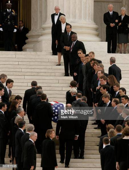 Pallbearers former law clerks of William Rehnquist carry the casket of the Chief Justice up the steps of the US Supreme Court past the current...