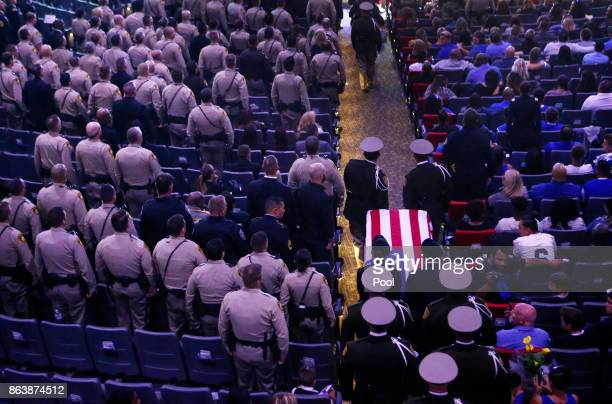 Pallbearers guide in the casket of Las Vegas police officer Charleston Hartfield during his funeral October 20 2017 in Henderson Nevada Hartfield was...