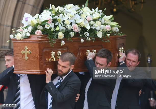 Pallbearers including Preston manager Simon Grayson and Fleetrwood Town manager Graham Alexander carry the coffin of Sir Tom Finney following his...