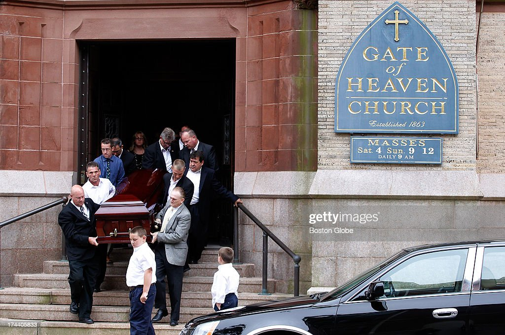 Pallbearers leave the funeral carrying the casket of Stephen M. Rakes at Gate of Heaven Church in South Boston, Mass., July 25, 2013. Rakes, who waited decades to testify against James 'Whitey' Bulger, was found dead earlier this month.