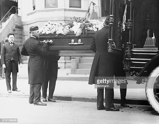 Pallbearers lifting the coffin of Leo M Frank who was lynched in Georgia in August of 1915