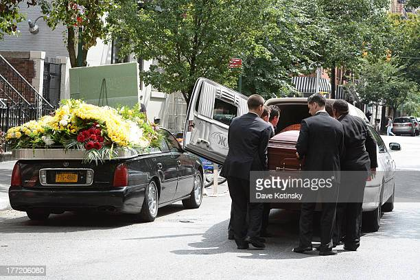 Pallbearers load the coffin into the hearse at the funeral for former 'Bachelor' contestant Gia Allemand at Trinity Grace Church on August 22 2013 in...