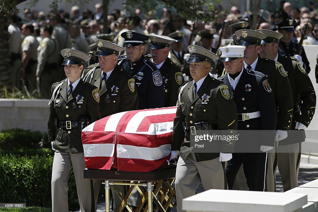 Pallbearers move the casket of Las Vegas Metropolitan Police Officer Alyn Beck during a memorial at The Smith Center for the Performing Arts Saturday, on June 14, 2014 in Las Vegas, Nevada. Police said Beck and Officer Igor Soldo were shot and killed on June 8 at a restaurant by Jerad Miller and his wife Amanda Miller. Police said the Millers then went into a nearby Wal-Mart where Amanda Miller killed Joseph Wilcox before police killed Jerad Miller and Amanda Miller killed herself.