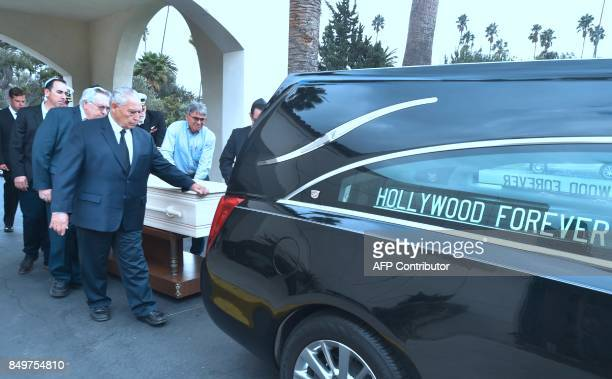 Pallbearers place into a vehicle the pine box coffin of Mitchell Flint on September 19 2017 at the Hollywood Forever cemetery in Hollywood California...