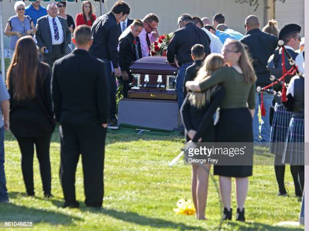 Pallbearers place the casket of Heather Lorraine Alvarado on a stand as other pay their respect at the cemetery on October 13 2017 in Enoch Utah...