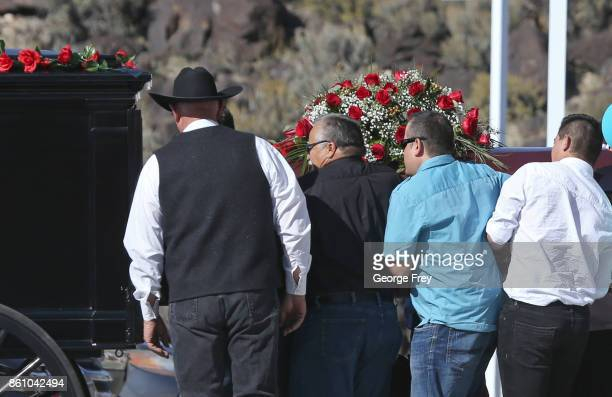 Pallbearers put the casket of Heather Lorraine Alvarado in a horse drawn hurst after her funeral services on October 13 2017 in Enoch Utah Alvarado...