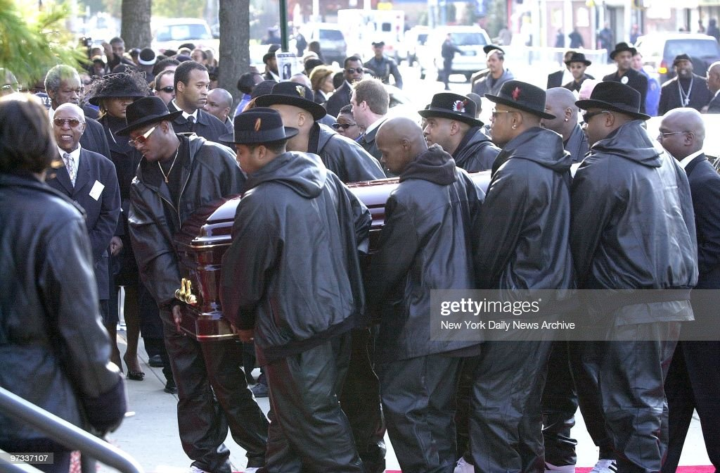 Pallbearers wearing trademark fedoras carry coffin of slain rap pioneer Jam Master Jay Jayson Mizell into AME Cathedral on Merrick Blvd in St Albans...