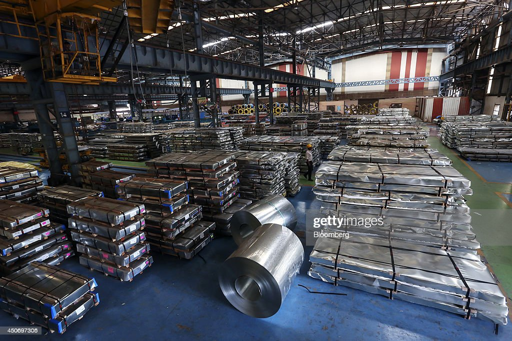 Pallets and coils of steel sit in the tube mill at the manufacturing facility of Uttam Galva Steels Ltd the Indian unit of ArcelorMittal in Khopoli...