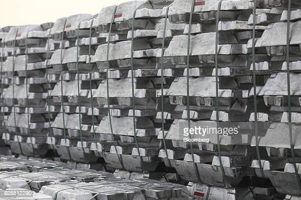 Pallets of aluminium ingots sit outside the aluminium processing area at the Ras Al Khair Industrial City operated by the Saudi Arabian Mining Co in...