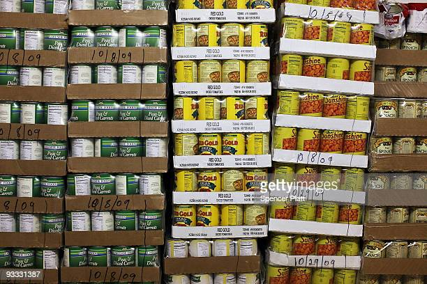 Pallets of canned goods are stacked inside the food pantry at St Augustine�s Church on November 23 2009 in the Bronx borough of New York City A new...