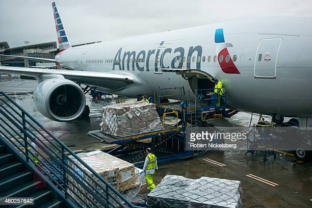 Pallets of cargo are unloaded from an American Airlines jet aircraft December 3 2014 at the Lops Angeles International Airport in Los Angeles...