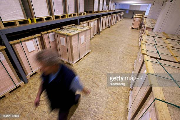 Pallets of completed cottonbased security paper sit in the secure storage facility at the Landqart AG paper mill in Landquart Switzerland on Thursday...