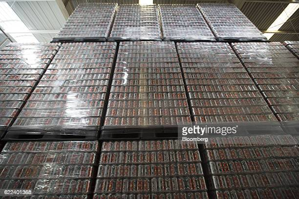Pallets of Heineken NV Dos Equis brand beer cans sit at the warehouse of the company's Cuauhtemoc Moctezuma production plant in Guadalajara Mexico on...