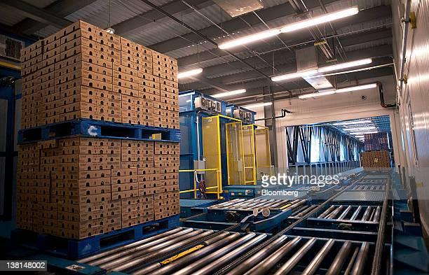 Pallets of yogurt move along a conveyor belt at the AgroFarma Inc facility in New Berlin New York US on Tuesday Jan 31 2012 AgroFarma Inc...