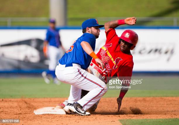 Palm Beach Cardinals Infielder Darren Seferina slides into second base with St Lucie Mets Infielder Michael Paez during the first game of a double...