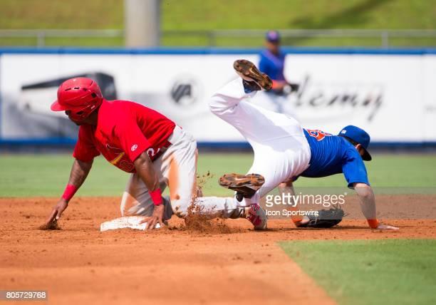 Palm Beach Cardinals Infielder Darren Seferina slides safely into second base knocking St Lucie Mets Infielder Michael Paez off of his feet during...