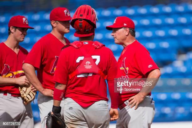 Palm Beach Cardinals Manager Dann Dilardello speaks with Palm Beach Cardinals Pitcher Connor Jones on the mound along with Palm Beach Cardinals...