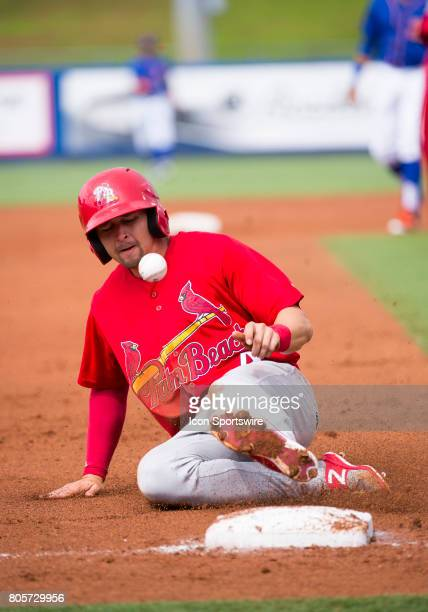 Palm Beach Cardinals Outfielder Thomas Spitz runs and slides into third base during the first game of a double header MiLB minor league baseball game...