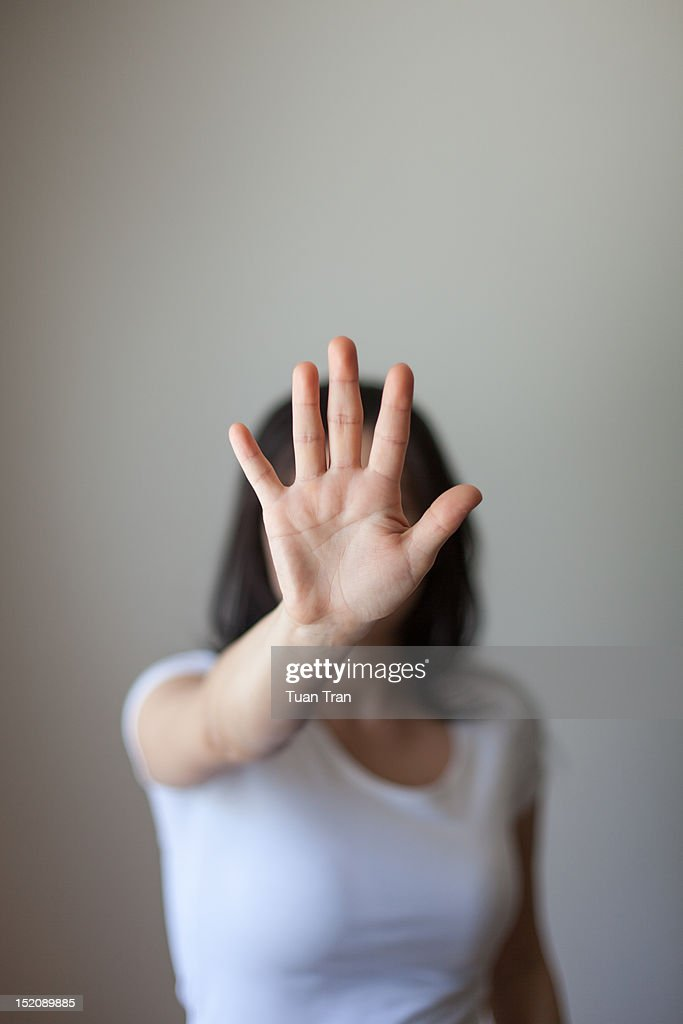 Palm covering face : Stock Photo