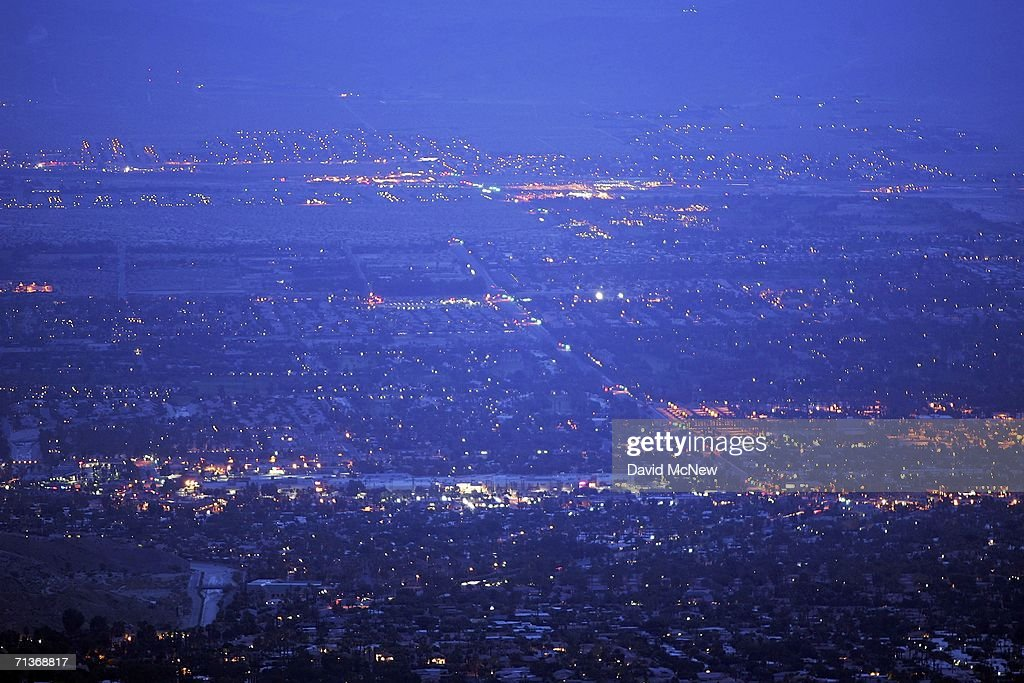 Palm Desert, in the Coachella Valley, where desert cities such as Palm Springs may be threatened by a major earthquake on the southern San Andreas Fault, is seen before dawn on July 4, 2006 near Palm Desert, California. Scientists have warned that after more than 300 years with very little slippage, the southern end of the 800-mile-long San Andreas fault north and east of Los Angeles has built up immense pressure and could produce a massive earthquake at any time. Such a quake could produce a sudden lateral movement of 23 to 32 feet which would be would be among the largest ever recorded. By comparison, the 1906 earthquake at the northern end of the fault destroyed San Francisco with a movement of no more than about 21 feet. Experts have concluded that a quake of magnitude-7.6 or greater on the lower San Andreas could kill thousands of people in the Los Angeles area with damages running into the tens of billions of dollars. The San Andreas Fault is where the Pacific and the North American tectonic plates of the Earth?s crust collide.