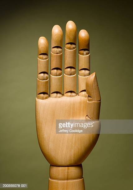 Palm of wooden hand, close-up