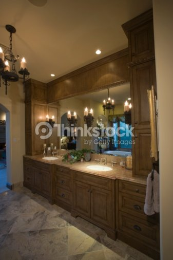 Palm Springs Bathroom With Lit Chandelier Stock Photo | Thinkstock