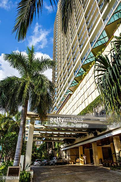 Palm trees and front exterior entrance of Trump International Hotel Waikiki Beach Five Star luxury hotel residences owned by Donald Trump wealthy...