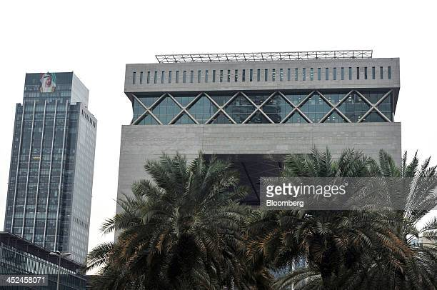 Palm trees are seen covering the main building of the Dubai International Financial Centre in Dubai United Arab Emirates on Thursday Nov 21 2013...