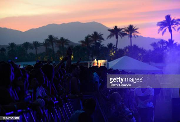 Palm trees are silhouetted against the sunset perform onstage during day 1 of the 2015 Coachella Valley Music Arts Festival at the Empire Polo Club...