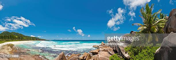 Palm trees sculpted granite rocks idyllic tropical island beach panorama