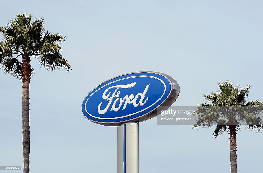 Palm trees stand next to a Ford dealership sign on January 29, 2013 in Glendale, California. According to reports the nation's second-largest automaker earned $1.7 billion in the fourth-quarter quarter, the highest pre-tax profit in a decade, up 55% from a year earlier. For the year, earnings slipped 5% to $5.7 billion.