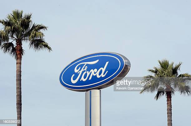 Palm trees stand next to a Ford dealership sign on January 29 2013 in Glendale California According to reports the nation's secondlargest automaker...