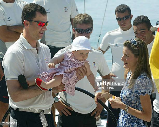 Spain's Pince Felipe is seen with his daughter Leonor and wife Letizia on board the yacht 'Aifos' at Puerto Portals on Mallorca 23 July 2006 The...