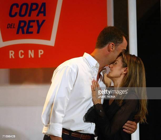 Spain's Prince Felipe kisses his wife Letizia during delivery of trophies of the 25th Copa del Rey regatta sailing at Bellver's Castle in Palma de...