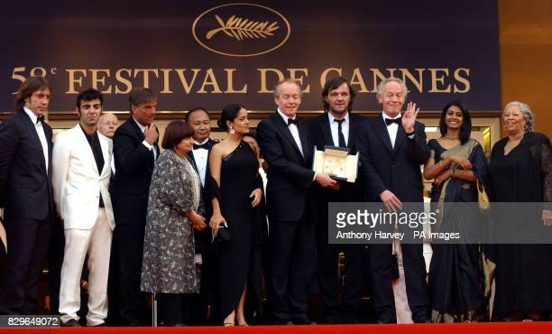 Palme d'Or winners JeanPierre Dardenne and Luc Dardenne pose with the Cannes jury