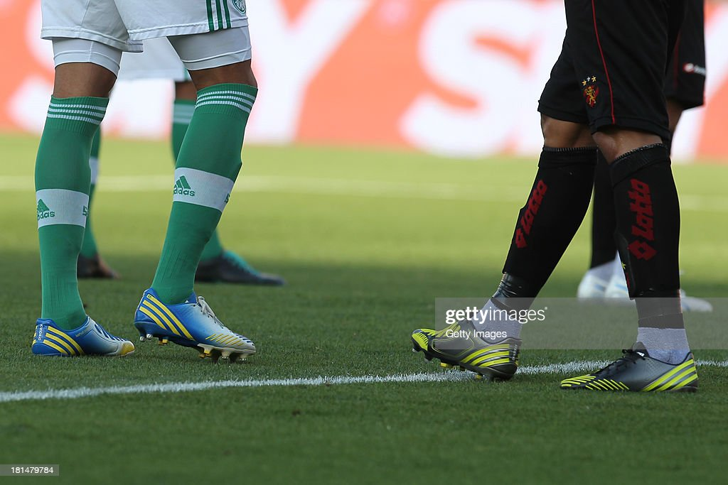 A Palmeiras player (L) and a Sport player wear Adidas shoes during the match between Palmeiras and Sport for the Brazilian Series B 2013 at Pacaembu stadium on September 21, 2013 in Sao Paulo, Brazil.