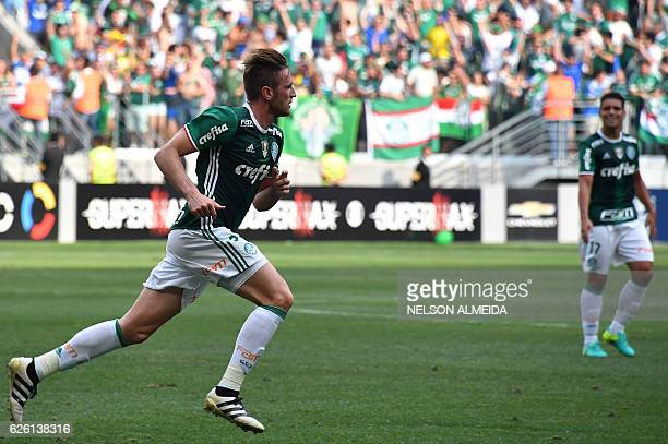 Palmeiras' player Fabiano celebrates his goal against Chapecoense during their Brazilian Championship football match at the Allianz Parque stadium on...