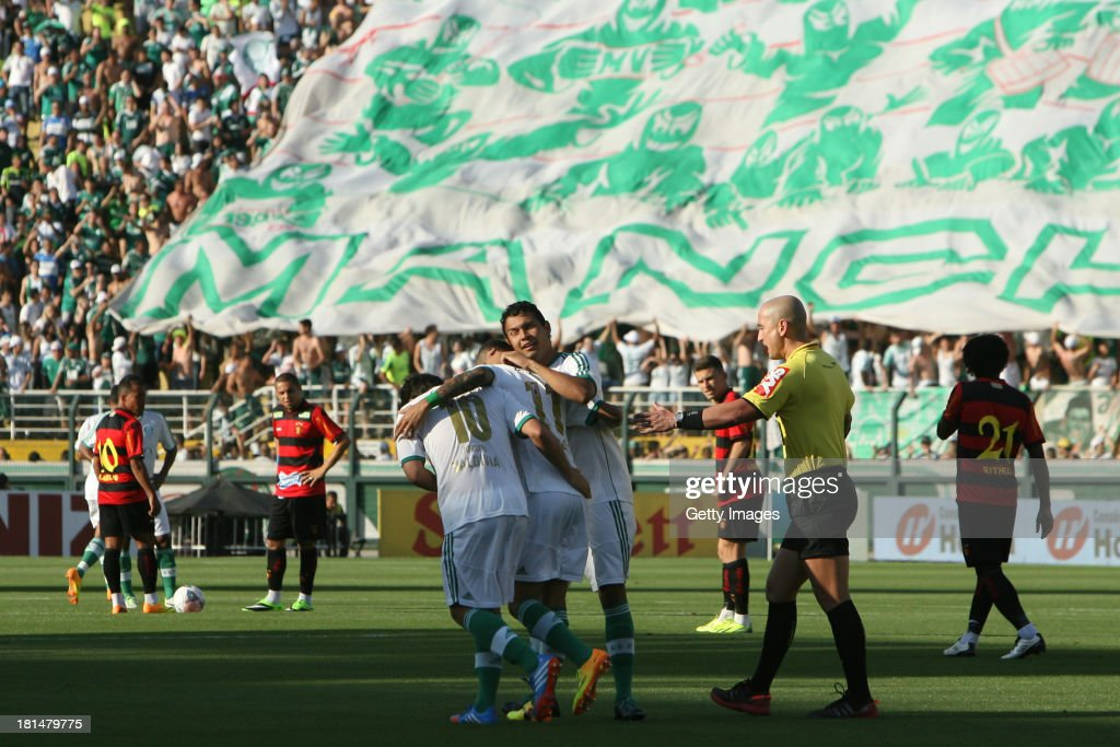 Palmeiras teammates celebrate the first scored goal during the match between Palmeiras and Sport for the Brazilian Series B 2013 at Pacaembu stadium on September 21, 2013 in Sao Paulo, Brazil.