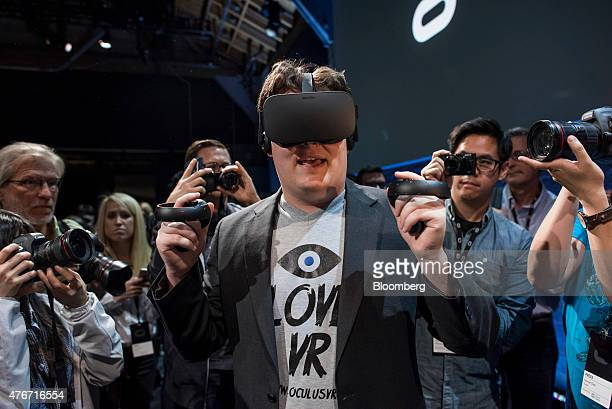 Palmer Luckey cofounder of Oculus VR Inc and creator of the Oculus Rift demonstrates the new Oculus Rift headset and Touch controller during the...