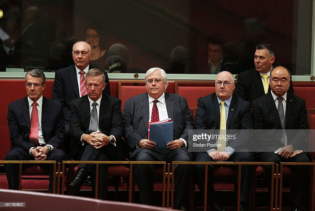 Palmer United leader <a gi-track='captionPersonalityLinkClicked' href=/galleries/search?phrase=Clive+Palmer&family=editorial&specificpeople=5874044 ng-click='$event.stopPropagation()'>Clive Palmer</a> (C) watches on during the official swearing in of the new Senate on July 7, 2014 in Canberra, Australia. Twelve Senators will be sworn in today, with the repeal of the carbon tax expected to be first on the agenda.