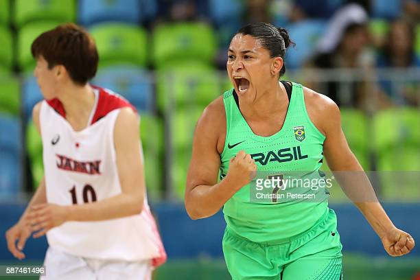 Palmira Marcal of Brazil celebrates after scoring against Ramu Tokashiki of Japan during the women's basketball game on Day 3 of the Rio 2016 Olympic...