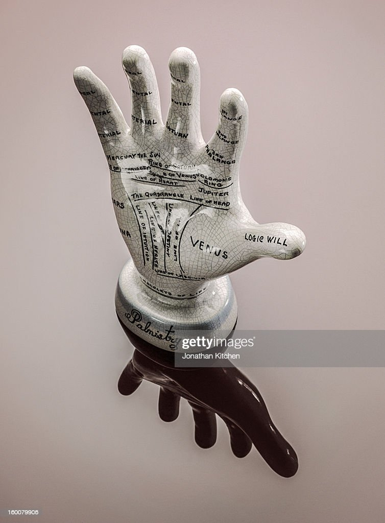 Palmistry hand on red : Stock Photo