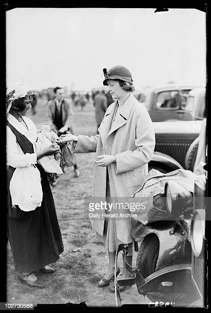 Palmreading at the races 1934 A photograph of a Romany woman telling another woman her fortune at the races taken by James Jarche for the Daily...