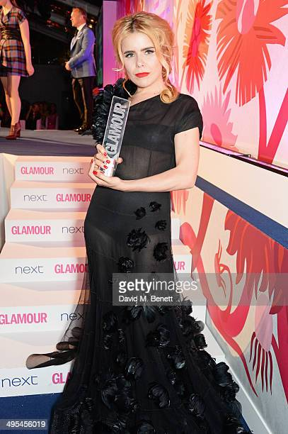 Paloma Faith poses with the UK Solo Artist award at the Glamour Women of the Year Awards in Berkeley Square Gardens on June 3 2014 in London England