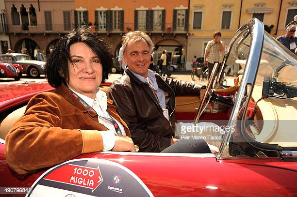 Paloma Picasso and Eric Thevent attend Mille Miglia 2014 1000 Miles Historic Road Race on May 15 2014 in Brescia Italy